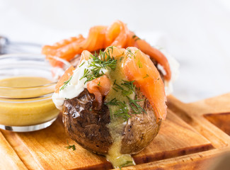 Jacket potatoes with  soft cheese and smoked salmon