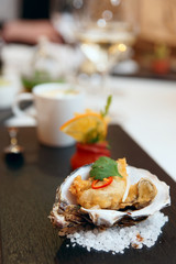 Tempura fried oyster in shell