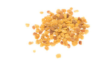 Top view of bee pollen against bright white background