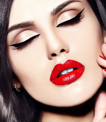 beautiful model with bright makeup with red lips