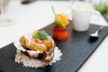 Tempura fried oyster in shell