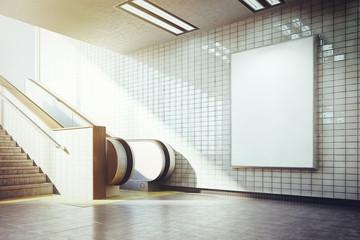 big vertical blank billboard with escalator