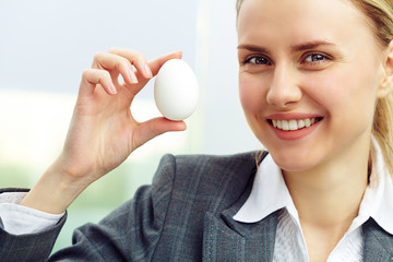 Businesswoman with egg