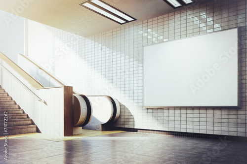 Leinwanddruck Bild big horizontal blank billboard with escalator
