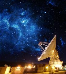 Satellite Antenna under beautiful star in blue sky.
