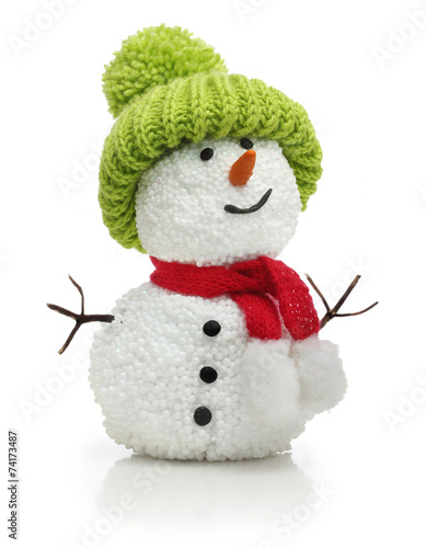 Foto op Canvas Wintersporten Snowman in green hat and red scarf