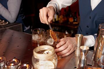 Barman works at bar counter