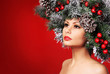 Christmas Woman. Fashion Girl with Decorated Hairstyle. New Year