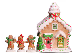 Gingerbread house and people isolated on white