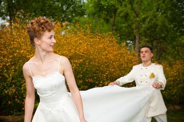 Happy wedding couple in nature.