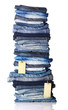 Pile of blue jeans with tags