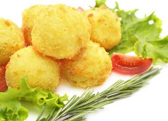 Potato rolls deep fried in crumbs with vegetables