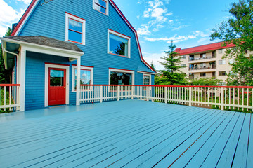 Large walkout deck with blue floor