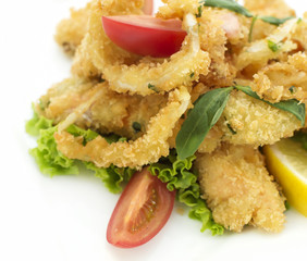 Deep fried fish in crumbs with vegetables