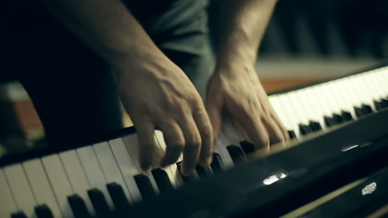 A man playing a melody on the piano