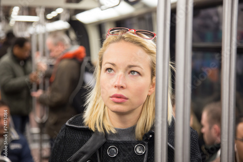 Leinwandbild Motiv Woman on subway.