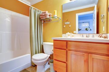 Bright yellow bathroom interior