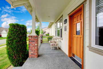 Spacious entrance porch with sitting area