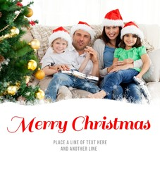 Composite image of portrait of a family at christmas on the sofa