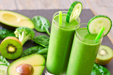 Green smoothie in glasses with avocado, kiwi and spinach