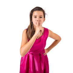 Girl making silence gesture over isolated white background