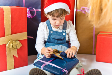 Brunette kid around several gifts