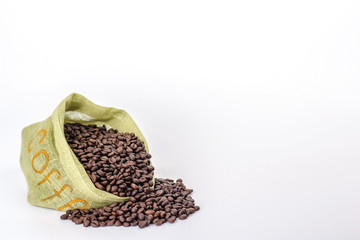 green bag full of coffee beans