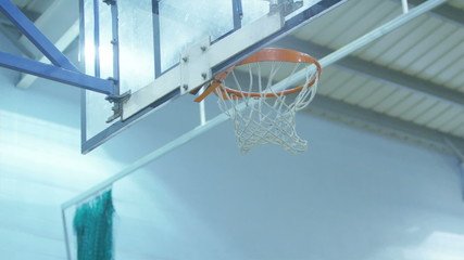Basketball player beating his defender and dunking