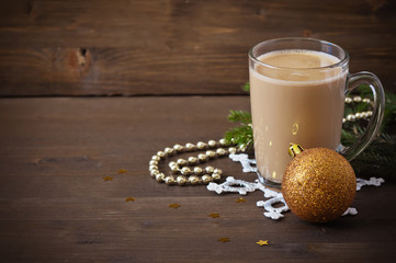 Christmas concept (decoration). Cup of coffee with gold ball