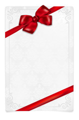 Paper card with red bow and floral ornaments
