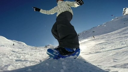 snowboarder on track in alpine mountains