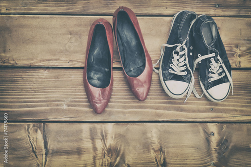 canvas print picture Different shoes on a wooden table