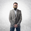 young businessman with gas mask over white background