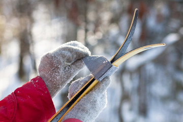 women's hands wrapping velcro strap around of the ski