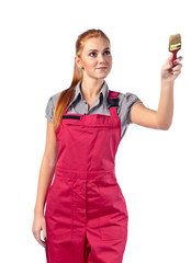 Young woman in red overalls with brush