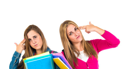 Student women making suicide gesture over white background