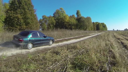 lonely car on  rural dirt road with. Aerial