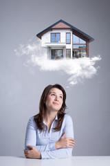 Woman dreaming about new house