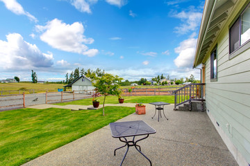 Countryside house exterior with concrete floor walkout patio