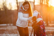 Mom and young daughter photograph with tripod together sunset