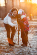 Mother and daughter photographing together at sunset light