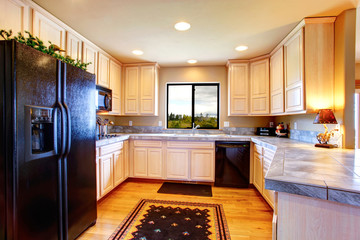 Kitchen room with light tone cabinets