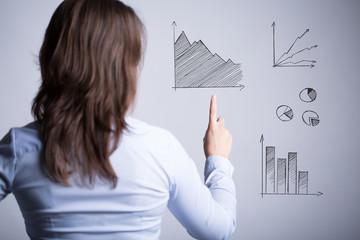 Woman among various charts