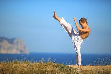 boy karate on the coast