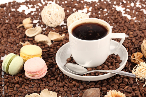 Coffee cup with bread and beans on a white background.