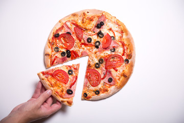 Male hand picking pizza slice