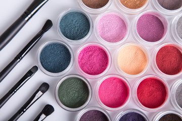 Set of bright mineral eye shadows and brushes