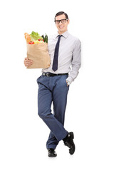 Elegant man holding a grocery bag