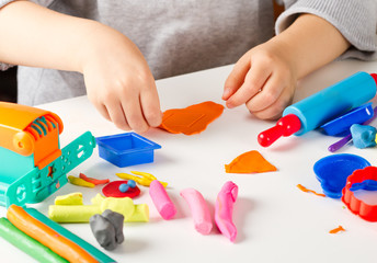 Child hands  with colorful clay
