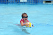 Child play with ball in swimming pool